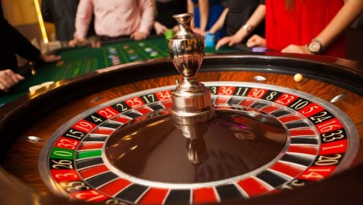 people playing at the roulette table